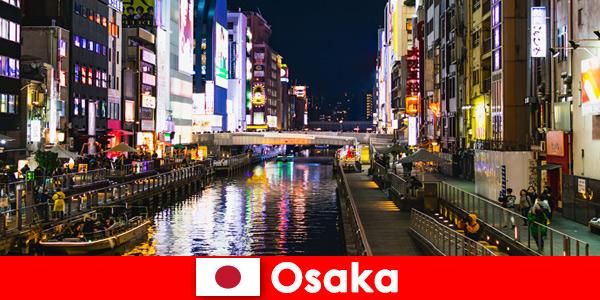 Districte de divertisment și delicatese așteaptă călătorii străini în Osaka Japonia